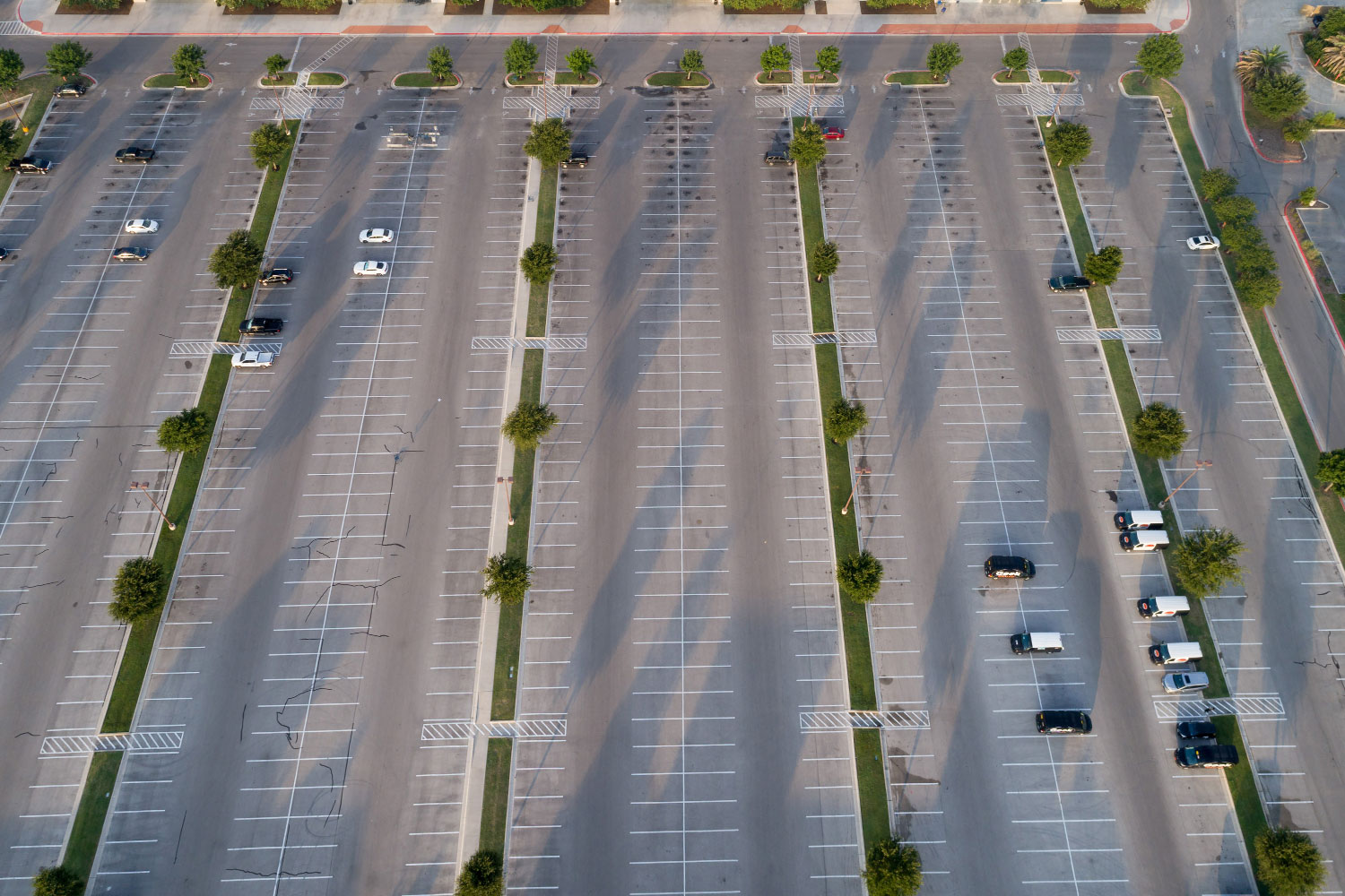 aerial parking lot that needs asphalt maintenance and striping