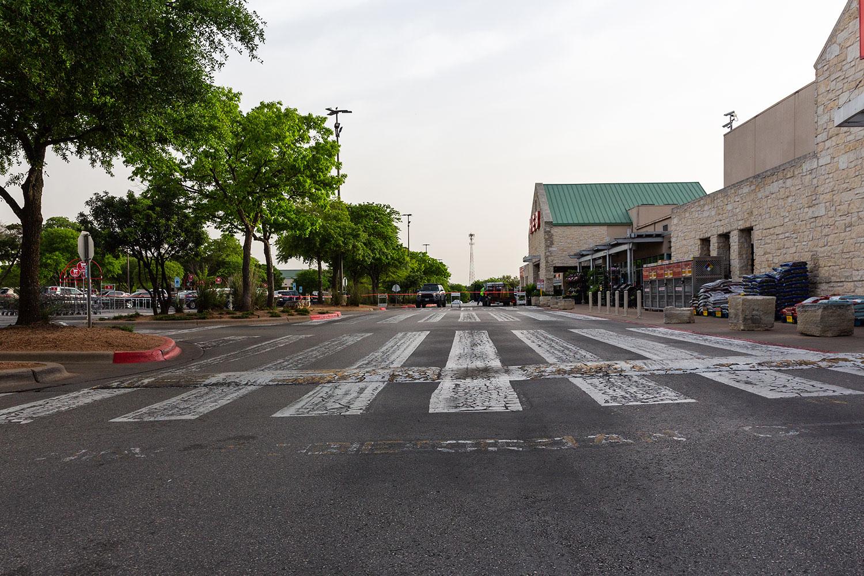 asphalt maintenance grocery store parking lot before